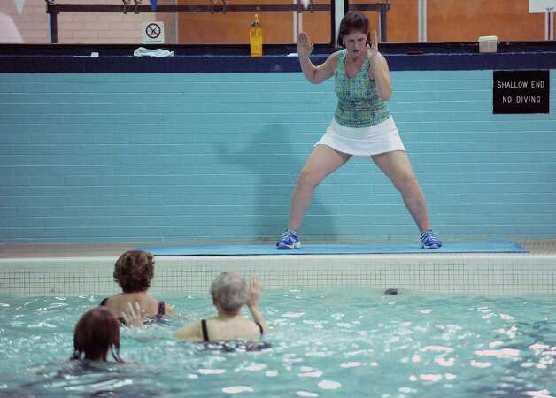 Water aerobics instructor Ann Frankel leads an aqua zumba class at the Albany Jewish Community Center on Wednesday, Jan. 23, 2013 in Albany, NY.   (Paul Buckowski / Times Union) Photo: Paul Buckowski  / 00020860A