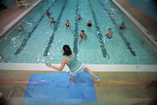 Water aerobics instructor Ann Frankel leads an aqua zumba class at the Albany Jewish Community Center on Wednesday, Jan. 23, 2013 in Albany, NY.   (Paul Buckowski / Times Union) Photo: Paul Buckowski