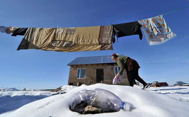 Hoping the sun will dry her clothes before they freeze, a woman hangs her laundry in Ak-Ordo, Kyrgyzstan, on the outskirts of the capital Bishkek. Photo: Vyachslav Oseledko, AFP/Getty Images