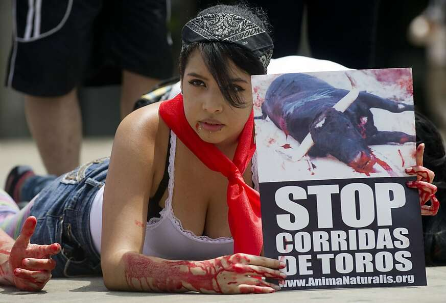 Dripping with fake blood, an AnimaNaturalis activist protests bullfighting in Medellin, Colom