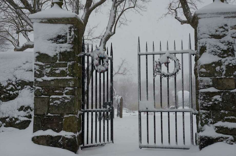 A chiling scene, lietrally, Friday afternoon as snow piles up from the day's snow storm at the colonial-era burial ground off Beach Road.   FAIRFIELD CITIZEN, CT 2/8/13 Photo: Genevieve Reilly / Fairfield Citizen