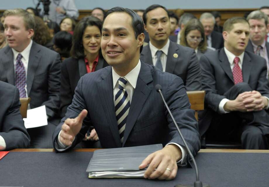 San Antonio Mayor Julián Castro (foreground; his brother, U.S. Rep. Joaquin Castro, is seated behind him) testifies on Capitol Hill Tuesday on immigration proposals. The mayor was greeted with deference. Photo: Susan Walsh, Associated Press