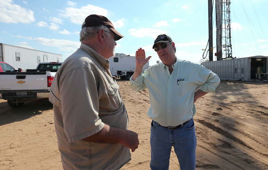 After a logging scan showed no prospects, third-generation wildcatter Harvey Howell, right, talks with company man, Jim McCracken, before shutting down operations at a drilling site in Frio County, Wednesday, Jan. 23, 2013. Photo: Jerry Lara, San Antonio Express-News / © 2013 San Antonio Express-News