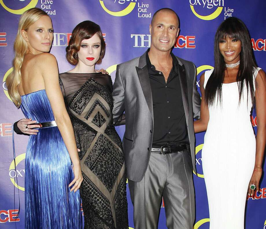 "Karolina Kurkova (from left), Coco Rocha and Naomi Campbell pose with photographer Nigel Barker at the premiere of the Oxygen series, ""The Face."" Photo: Associated Press"