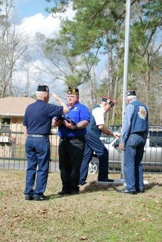 The flag raising ceremony was a proud moment for Bill Gilbreath and his fellow veterans. Photo: Jay Cockrell