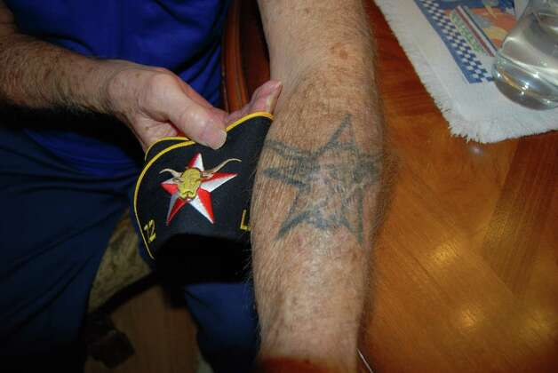 The tattoo on his arm matches the Navy emblem on his cap; Gilbreath had it put on the night after he returned from overseas. Photo: Jay Cockrell / Jay Cockrell