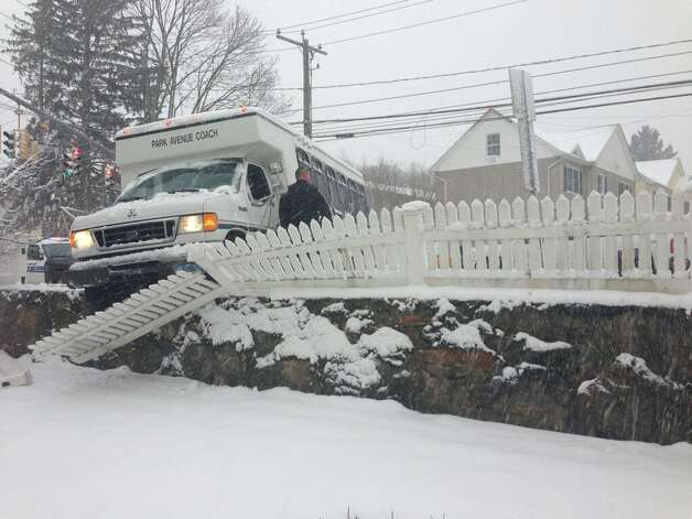 Nemo sends a bus into a Stamford home's yard. Photo: Contributed