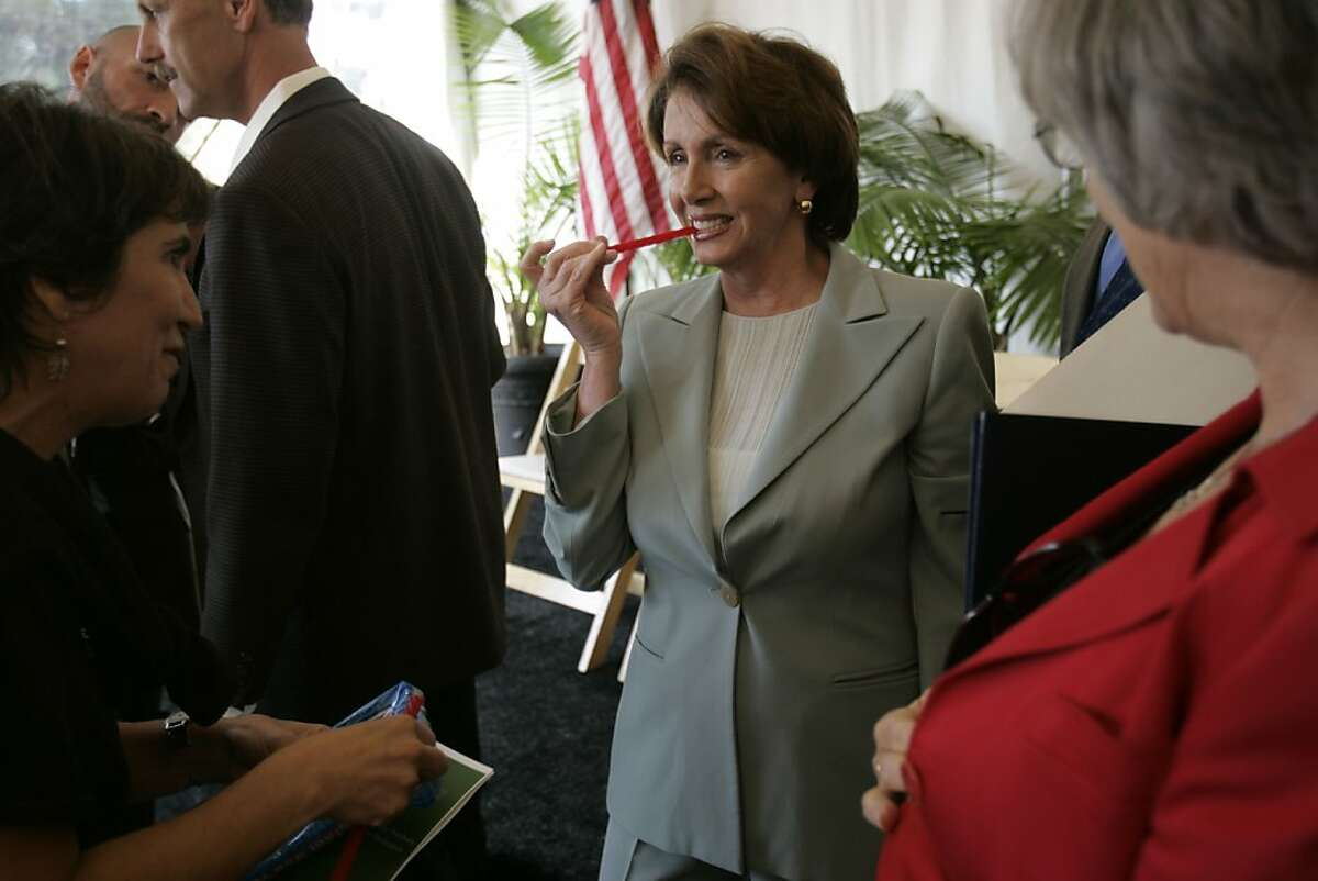 pelosi_076_mac.jpg Congresswoman Pelosi takes a break and eats a piece of licorice as she visits with friends. Congresswoman Nancy Pelosi, Democratic Leader, at a dedication ceremony to honor Dr. Ed Wayburn, environmentalist, as a redwood grove is dedicated in his name in the Presidio of San Francisco. Event in, San Francisco, Ca, on 10/11/06. Photo by: Michael Macor/ San Francisco Chronicle