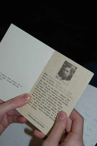 Each student was given a booklet to read that told a prisoner s story. Photo: Jay Cockrell