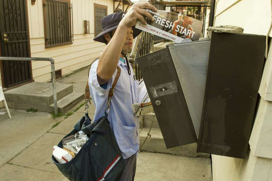 The U.S. Postal Service plan to stop delivering mail on Saturdays is a cut that Americans can handle. Photo: Damian Dovarganes, Associated Press
