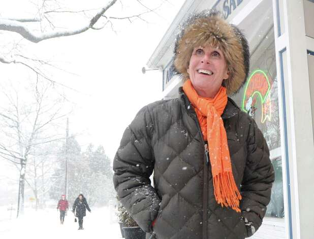 Lisa Berizzi of Cos Cob smiles as she watches the snow fall on East Putnam Avenue in Cos Cob during the storm that hit Greenwich, Conn., Friday, Feb. 8, 2013. Photo: Bob Luckey / Greenwich Time
