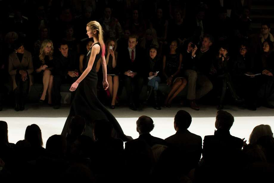 Black was a favorite of designer Carmen Marc Valvo in his Fall 2013 collection. Photo: John Minchillo, FRE / FR170537 AP