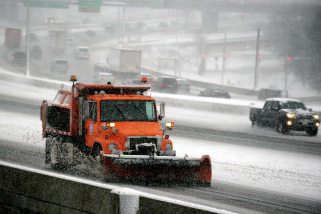 A DOT truck plows snow along I-95, in Bridgeport, Conn., Feb. 8th, 2013. Photo: Ned Gerard / Connecticut Post