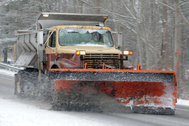 A snow plow moves snow along Nells Rock Rd., in Shelton, Conn. Feb. 8th, 2013. Photo: Ned Gerard / Connecticut Post