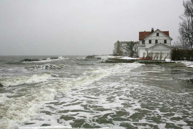The wind and waves were starting to pick up on Greenwich Point ahead of the snowstorm Friday, Feb. 8, 2013. Photo: David Ames / Greenwich Time Freelance