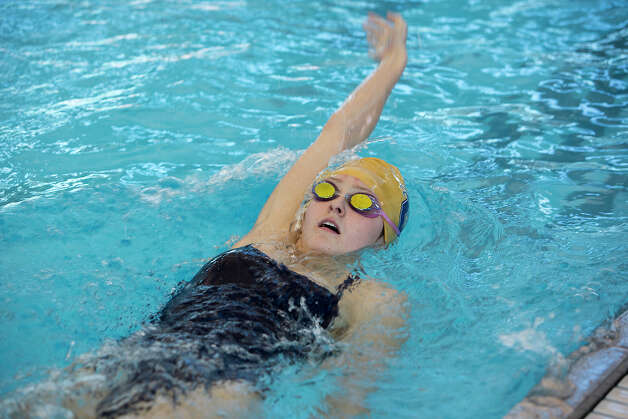 O'Connor swimmer Abby McAlpin practices her backstroke at the NISD Natatorium on Tuesday, Feb. 5, 2013. MICHAEL MILLER / FOR THE EXPRESS-NEWS Photo: Michael Miller, Express-News / For the Express-News
