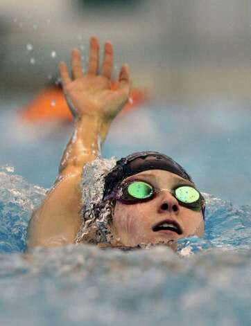 Abby McAlpin, a medal winner in this year's World Deaf Swimming Championships, practices at Northside Natatorium. The junior at O'Connor High School plans to return to the 2013 Deaflympics. Friday, Nov. 18, 2011. Photo Bob Owen/rowen@express-news.net Photo: BOB OWEN, Express-News / rowen@express-news.net