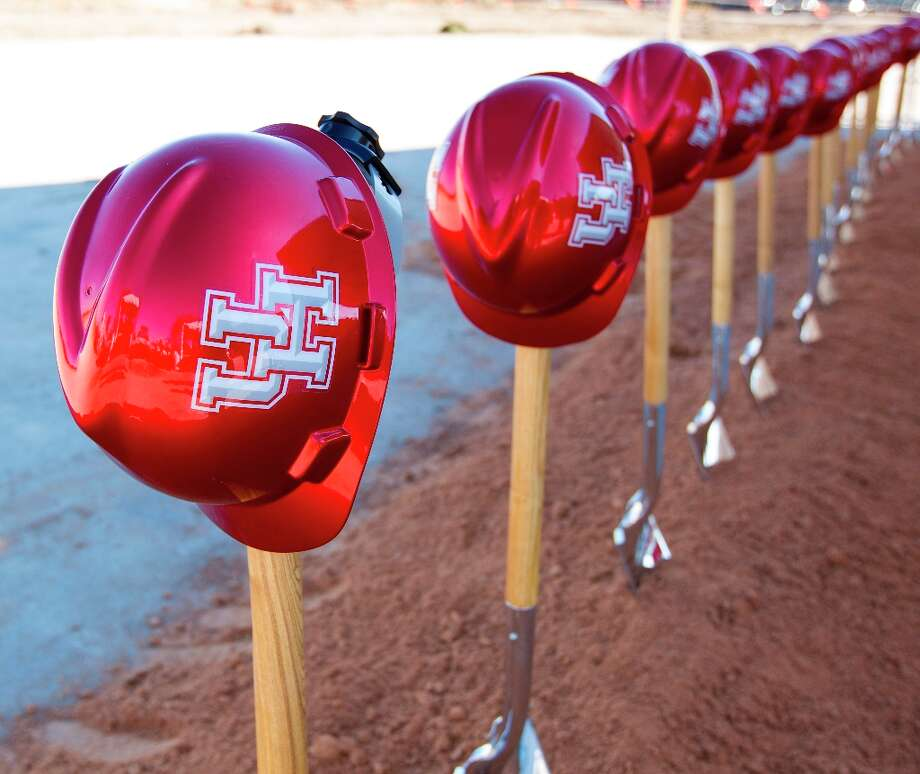 A line of hard hats and shovels during the groundbreaking ceremony for the new University of Houston football stadium on Friday. The Houston football stadium will contain a minimum of 40,000 seats and will be completed by August 2014. Photo: Karen Warren / © 2013 Houston Chronicle
