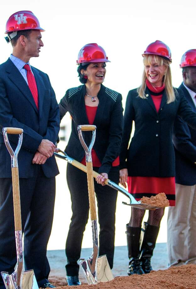Renu Khator, president of the University of Houston, center laughs with Nelda Luce Blair, chair of the UH System Board of Regents, right, as they prepare for a photo op with hard hats and shovels during the groundbreaking ceremony. Photo: Karen Warren / © 2013 Houston Chronicle