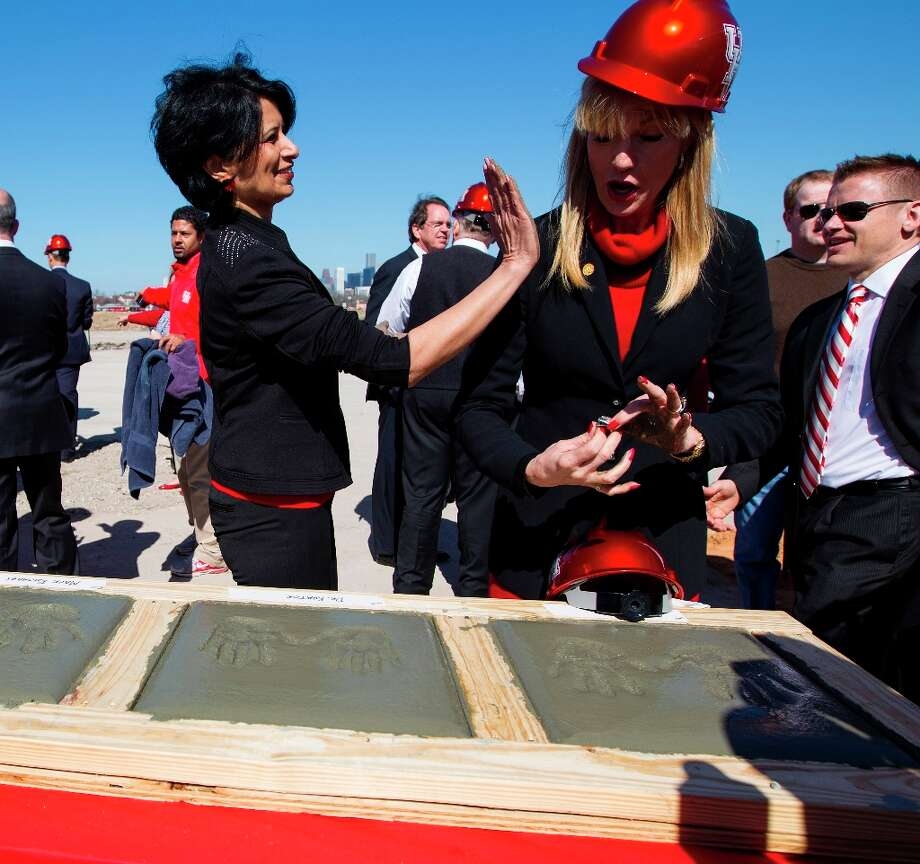 University of Houston president Renu Khator, left, acts like she is about to wipe her concrete covered hands on Nelda Luce Blair, right, Chairman of the UH System Board of Regents, as they finish their hand prints in concrete during the groundbreaking ceremony. Photo: Karen Warren / © 2013 Houston Chronicle