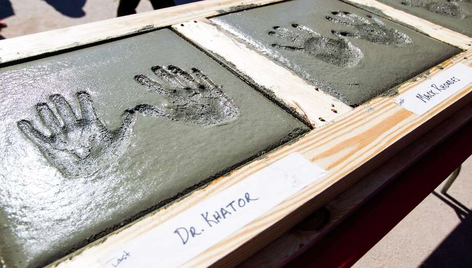 University of Houston president Renu Khator's hand prints in concrete, along with those of Mack Rhoades, VP of Intercollegiate Athletics during the groundbreaking ceremony. Photo: Karen Warren / © 2013 Houston Chronicle