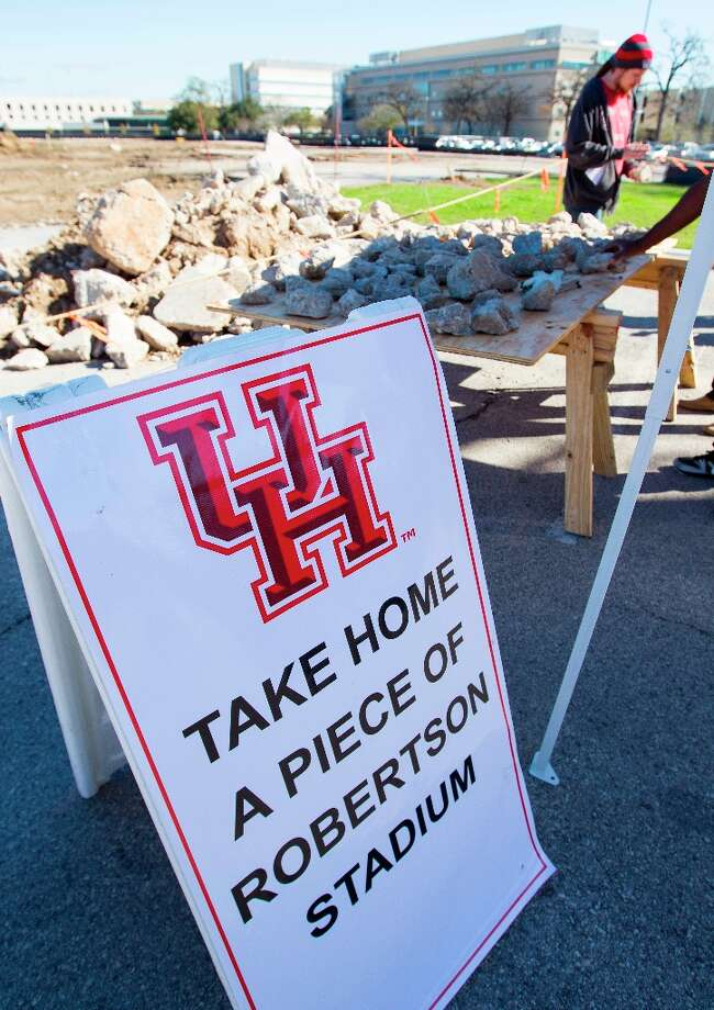 A booth offering pieces of Robertson Stadium nearby during the groundbreaking ceremony. Photo: Karen Warren / © 2013 Houston Chronicle