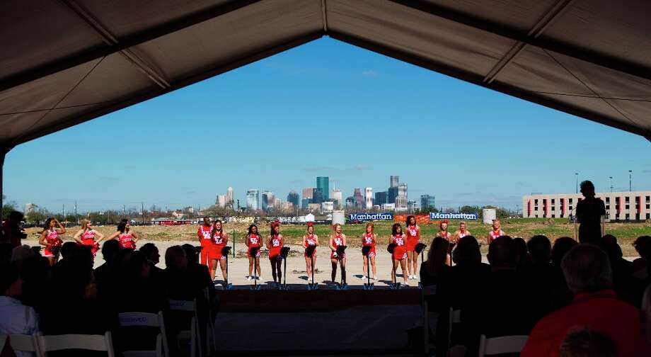 UH cheerleaders line up behind a row of hard hats on top of shovels as UH President Renu Khator speaks to the crowd during the groundbreaking ceremony. Photo: Karen Warren / © 2013 Houston Chronicle