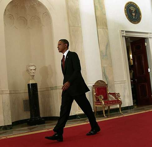 President Barack Obama walks down the Cross Hall on the way to the East Room to make a televised statement on the death of Osama bin Laden from the White House in Washington, Sunday, May 1, 2011. Photo: Pablo Martinez Monsivais, ASSOCIATED PRESS