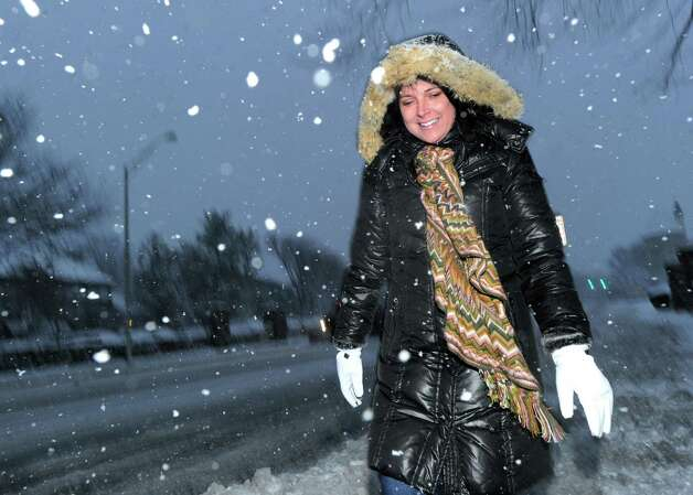 Becky Spivey of Wilmington, N.C., walks along a snowy East Putnam Avenue during the snowstorm that hit Greenwich, Conn., Friday night, Feb. 8, 2013. Spivey said she was in town for a real estate conference and made the last flight into LaGuardia Airport before flights were cancelled. Photo: Bob Luckey / Greenwich Time