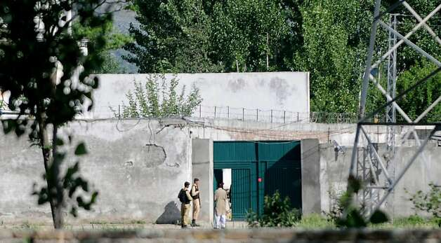Pakistani soldiers stand guard near Al-Qaeda chief Osama Bin Laden's final hideout in Abboattabad's Bilal Town on May 8, 2011 where bin Laden was killed in a US Naval Commandos special operation. Photo: Asif Hassan, AFP/Getty Images