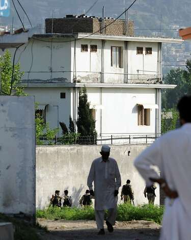 Pakistani soldiers surround the final hideout of slain Al-Qaeda chief Osama Bin Laden as local residents gather in Abboattabad on May 9, 2011 where bin Laden was killed in a US Naval Commandos special operation. Photo: Aamir Qureshi, AFP/Getty Images 2011