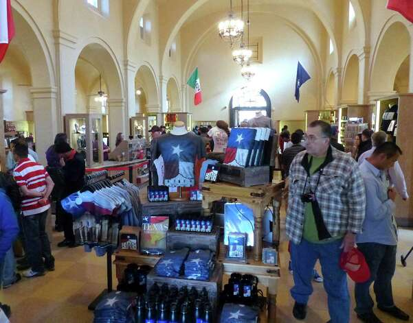 Shoppers browse the Alamo Gift Shop during the first day of its reopening on Friday, Feb. 8, 2013. Photo: Billy Calzada, San Antonio Express-News / San Antonio Express-News