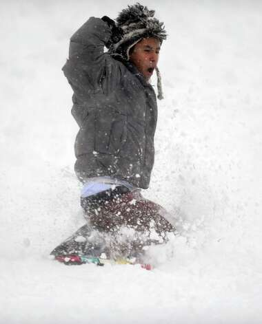 Guillermo Sanchez, 19, of Derby, sleds down the hill behind Derby Middle School in Derby, Conn. Friday, Feb. 8, 2013. Photo: Autumn Driscoll