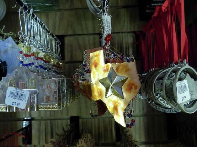 Decorations are on sale in the Alamo Gift Shop during the first day of its reopening on Friday, Feb. 8, 2013. Photo: Billy Calzada, San Antonio Express-News / San Antonio Express-News