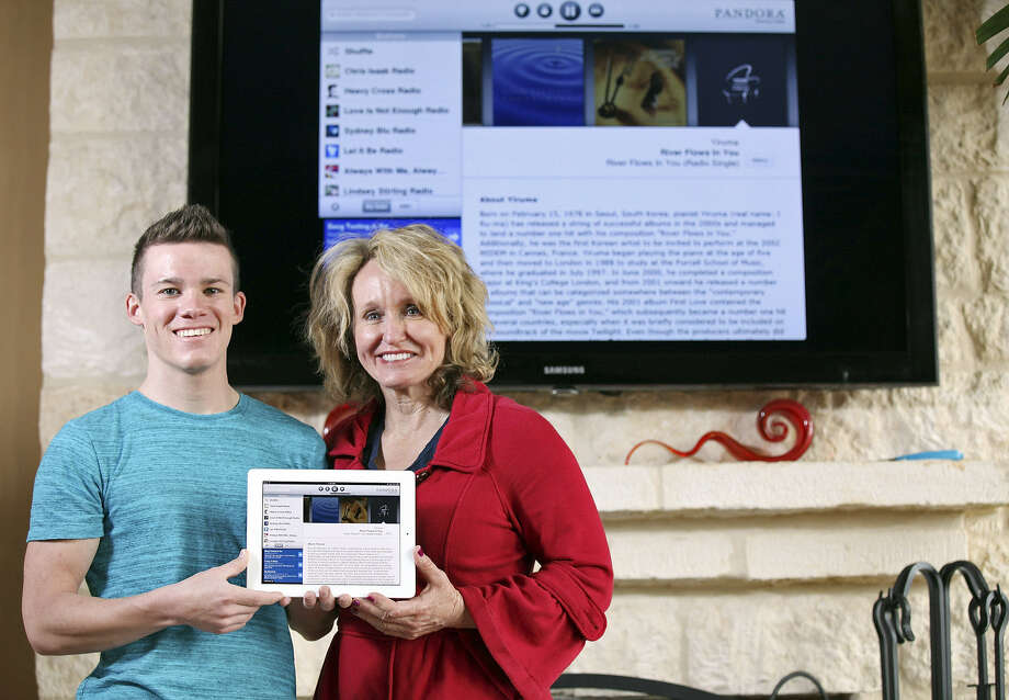 Suzanne Gazda and son Sean Lubowiecki can control home audio, video and lighting on their iPad and television. With today's systems, smart-home controls are in the palm of your hand. Photo: Photos By Edward A. Ornelas / Express-News