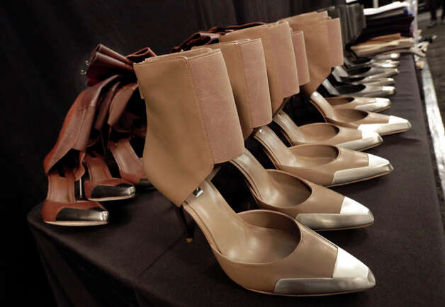Shoes are lined up on a table backstage before the BCBG Max Azria Fall 2013 collection is modeled, during Fashion Week in New York,  Thursday, Feb. 7, 2013. (AP Photo/Richard Drew) Photo: Richard Drew, Wire Photos / AP