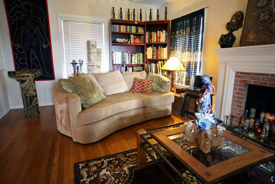 When Laurel Gibson bought her Monticello Park home, she knew it would allow ample display space for her ceramics and embroidered artwork. Photo: Photos By Danny Warner / For The Express-News