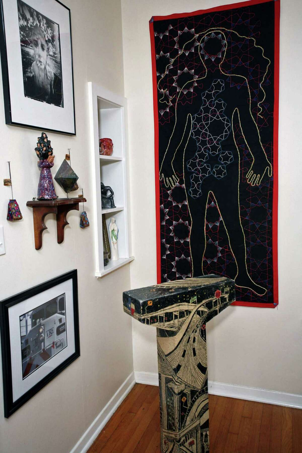 Ceramics and embroidered artwork decorate the living room.