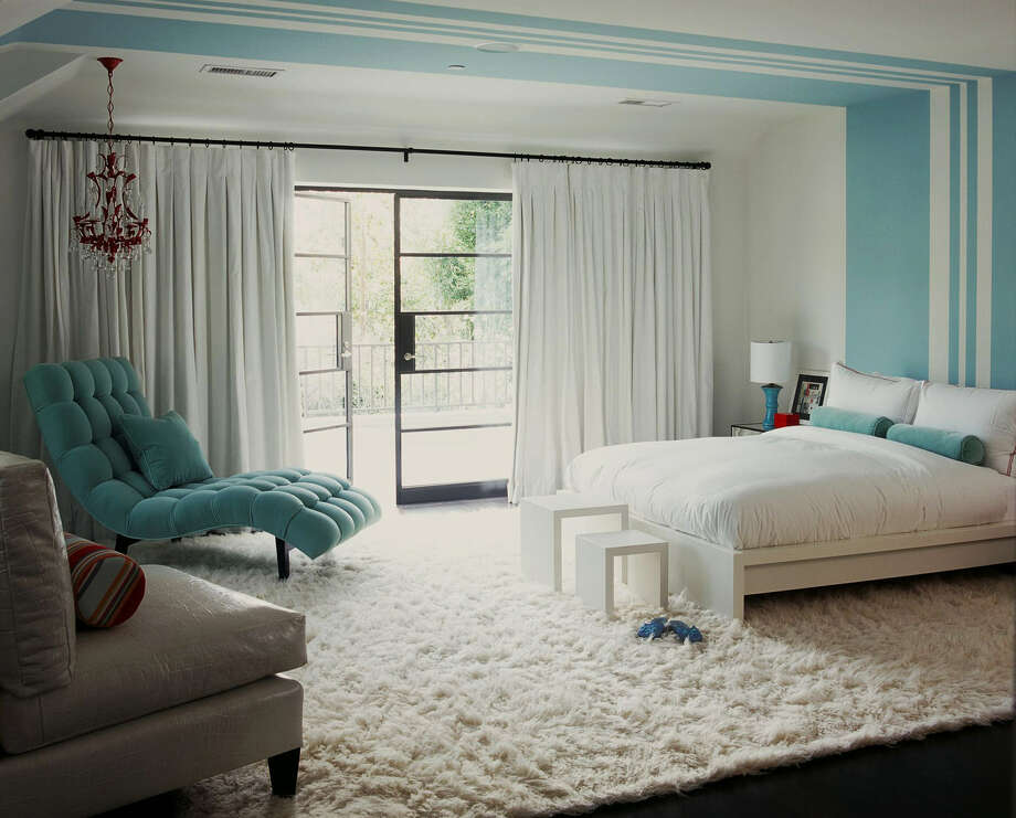 Bedroom walls of pure white and frosty blue are complemented by a fluffy snow-white flokati rug. Photo: Associated Press Photos