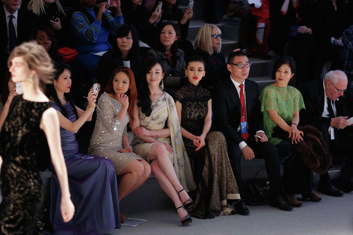 NEW YORK, NY - FEBRUARY 07: (L to R) Chiu-ti Jansen, Zhang Meng, and Gong Xiliang attend the Tadashi Shoji Fall 2013 fashion show during Mercedes-Benz Fashion Week at The Stage at Lincoln Center on February 7, 2013 in New York City. (Photo by Jemal Countess/Getty Images for Mercedes-Benz Fashion Week)
