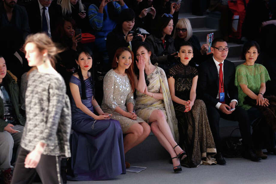 NEW YORK, NY - FEBRUARY 07:  (L to R) Chiu-ti Jansen, Zhang Meng, and Gong Xiliang attend the Tadashi Shoji Fall 2013 fashion show during Mercedes-Benz Fashion Week at The Stage at Lincoln Center on February 7, 2013 in New York City.  (Photo by Jemal Countess/Getty Images for Mercedes-Benz Fashion Week) Photo: Jemal Countess, Wire Photos / 2013 Getty Images