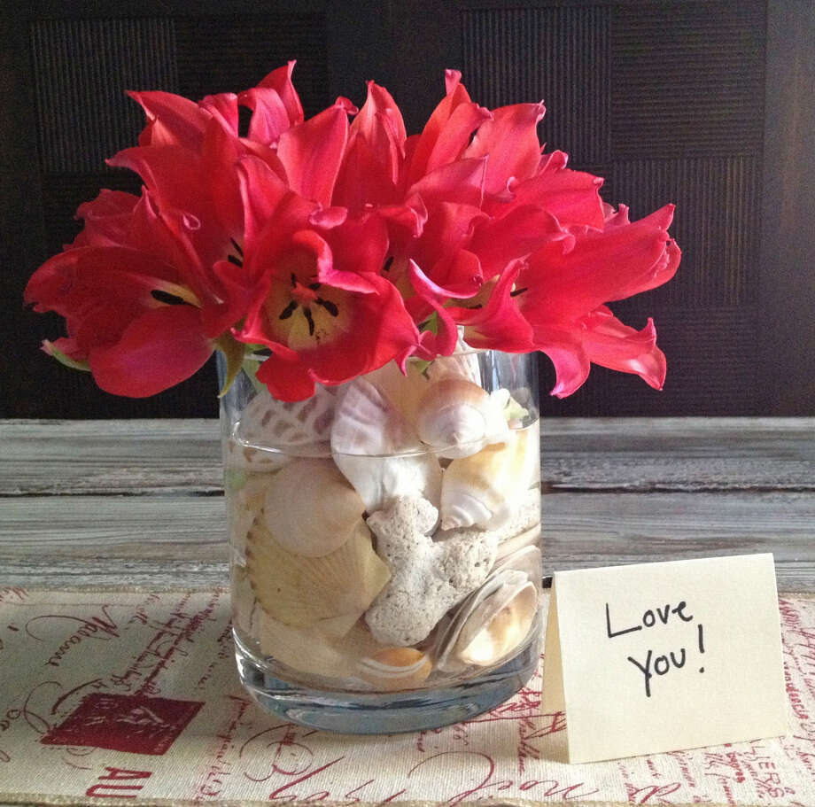 Seashells help steady a simple bouquet. Photo: McClatchy-Tribune Service