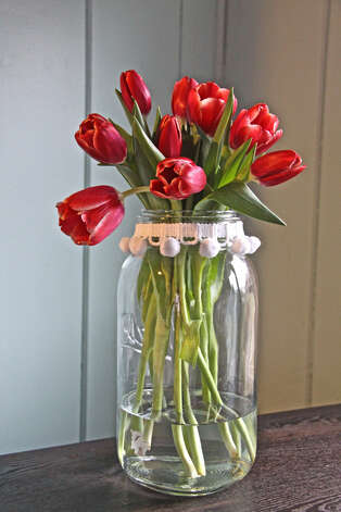 Pompon trim turns a Mason jar into a special vase.