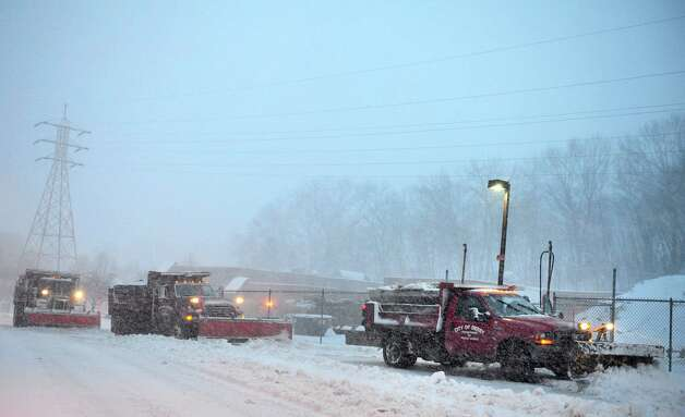 Plow trucks line up to refill their gasoline tanks outside the Public Works Department in Derby, Conn. Friday, Feb. 8, 2013. Photo: Autumn Driscoll