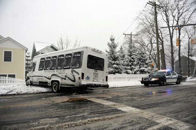 A bus sits off the road and against a fence on a slippery road during the blizzard Friday, February 8, 2013. Photo: Lindsay Perry / Stamford Advocate