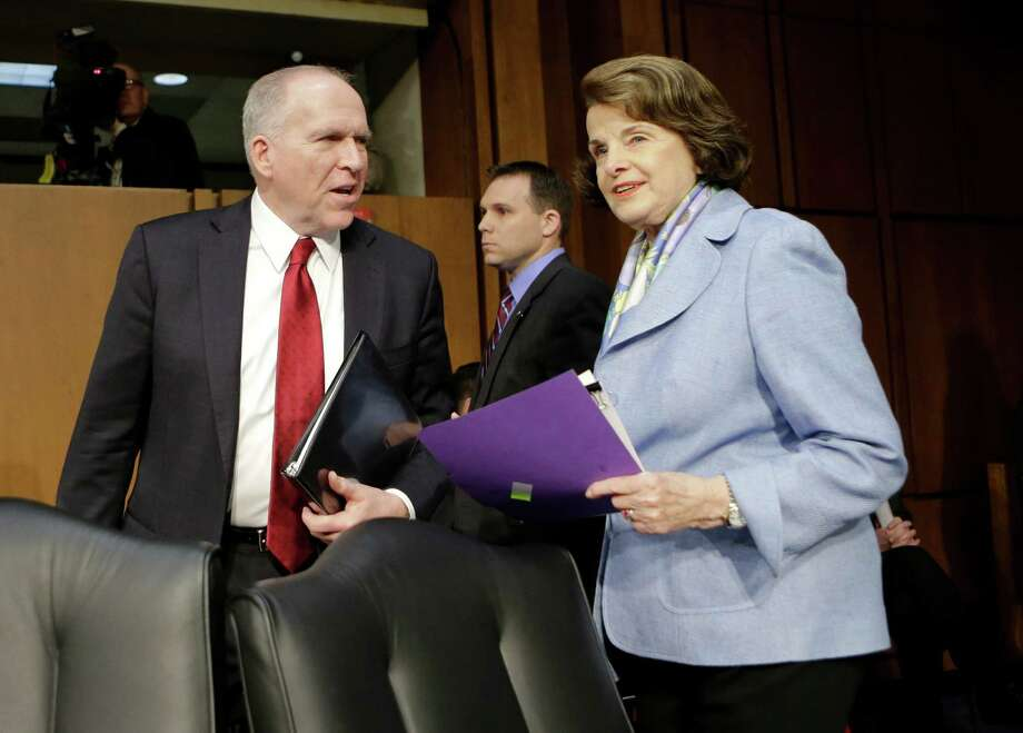 FILE - In this Feb. 7, 2013 file photo, Senate Intelligence Committee Chair Sen. Dianne Feinstein, D-Calif., right, welcomes CIA Director nominee John Brennan on Capitol Hill in Washington, prior to the start of Brennan's confirmation hearing before the committee. Lawmakers are considering whether Congress can set up a court to decide when drones can kill U.S. citizens overseas, much like the secret courts that now grant permission for surveillance. It's another sign of the U.S. philosophical struggle over remote warfare, raised after CIA head nominee John Brennan's vigorous defense of the drones. (AP Photo/J. Scott Applewhite, File) Photo: J. Scott Applewhite
