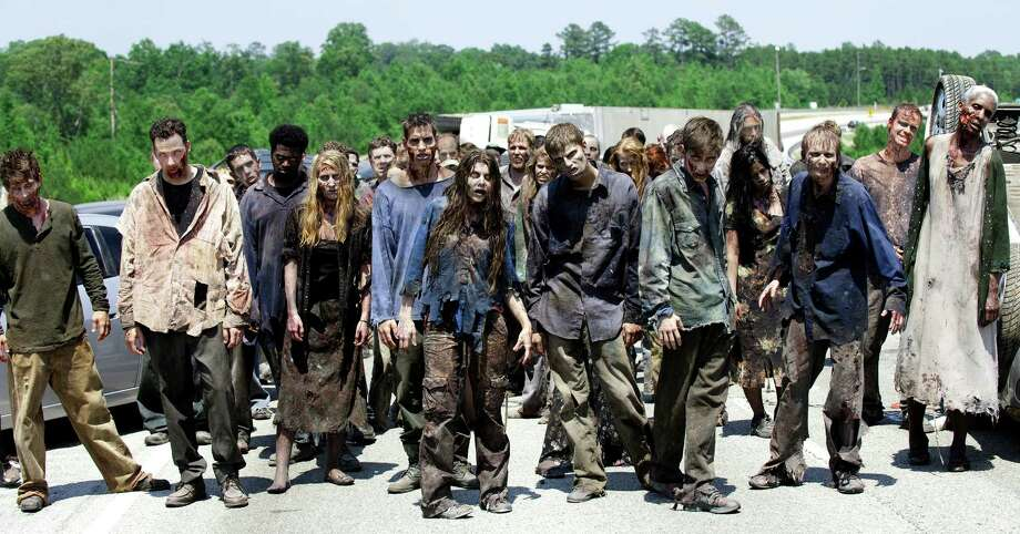 The group is on the highway and encounter a large group of walkers headed their way. They have no choice to but to hide when Carol's daughter, Sophia gets lost. Photo: Gene Page, Gene Page/Courtesy Of AMC