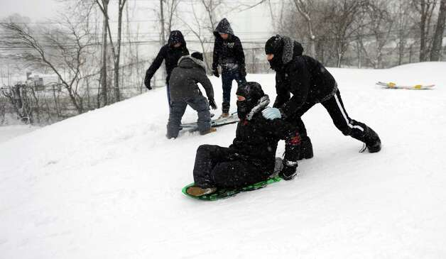Kids and adults take advantage of the weather to snowboard and sled at E. Gaynor Brennan Municapal Golf Course during the blizzard Friday, February 8, 2013. Photo: Lindsay Perry / Stamford Advocate
