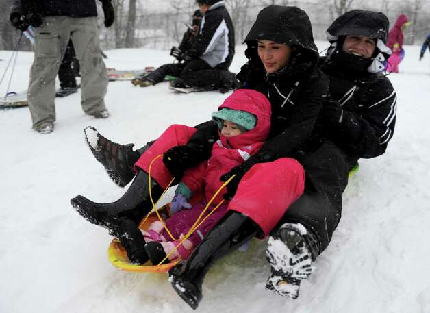 From left, Algeria Rojas, 1, Natalia Rojas, and Alexander Rojas sled at E. Gaynor Brennan Municipal Golf Course during the blizzard Friday, February 8, 2013. Photo: Lindsay Perry / Stamford Advocate
