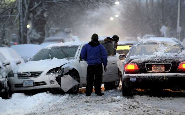 A car accident blocks Schuyler Ave. in Stamford, Conn., during the blizzard Friday, February 8, 2013. Photo: Lindsay Perry / Stamford Advocate